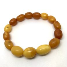 Antique bracelet ca. 1900 of genuine Baltic amber (not modified, not treated) olive beads 11-16mm in length , egg yolk - bee wax