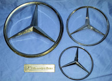 Four Mercedes Benz emblems