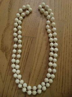 A long white coral necklace for wearing in two rows