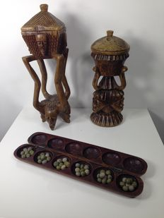 Lot of: two large handcarved wooden vessels (39cm and 48cm) and one wooden Mancala (Wouri or Awari) board game