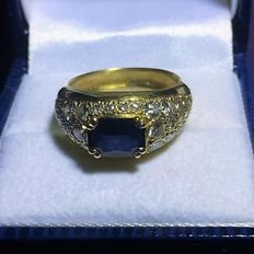 Ring in gold set with 36 diamonds and a sapphire > 2 ct, from 1985.