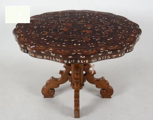 A round rosewood table - inlaid with boxwood and bone -probably Chinese make for the European market - at the end of the 19th century