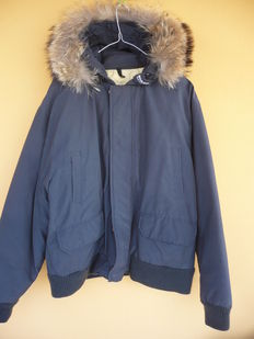 Woolrich John Rich & Bros. – Goose down jacket with hood.