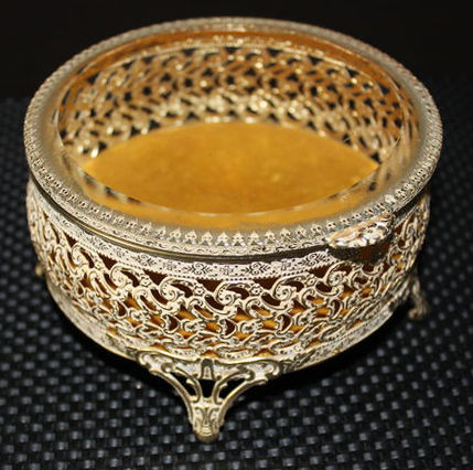 Vintage filigree ormolu gilt jewellery box with bevelled glass lid
