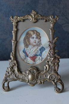 Hand painted miniature on celluloid in a bronze frame, Napoleon as a child - Signed by the artist - France - late 19th/early 20th century