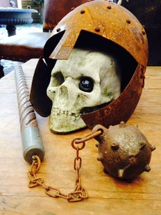 """Lost fight"" skull with metal helmet and flail."