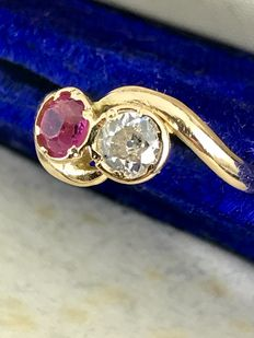 Diamond and Ruby crossover ring tested 18k