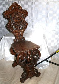 Ornately carved, antique, oak wood chair, early 20th century