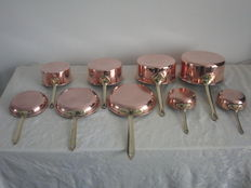 a lot off copper pans