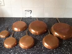 7 red copper frying pans