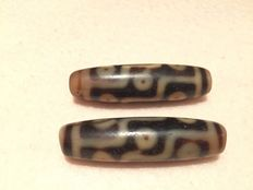 A pair of agate nine eye dZi beads – Tibet/ Himalayas - 2nd half of the 20th century