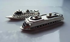 Two miniature silver cruise ships, hand-made