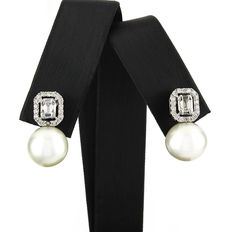 White gold earrings with baguette cut diamonds and Australian South Sea pearls measuring 11 mm.