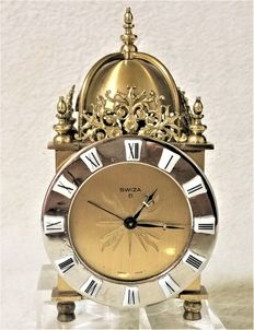 Swiss eight day clock in solid bronze, very heavy – Alarm – Numbers on porcelain