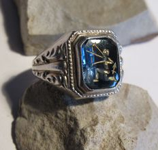 Antique, silver ring with Sagittarius, with gold leaf accent. Approx. 1910.