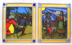 Two stained glass decorations with colourful pictures