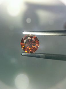 0.46 carat  fancy vivid Cognac (orange-red) round shape diamonds. Clarity -VS2