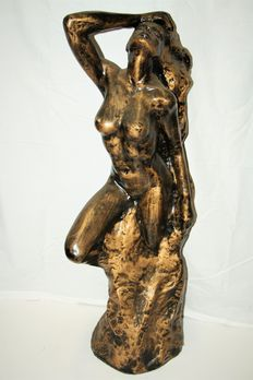 Statue; Naked young woman in rock-21st century
