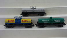 "Märklin H0 - 45580 - 3-piece metal tanker set as prototypes No. 27 ""6000 Gallon"" of different American Railroads"