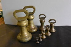 Eight bronze Bell weights - calibrated - England - ca. 1910
