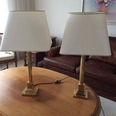 Two antique brass lamp bases (Corinthian columns) with lampshades