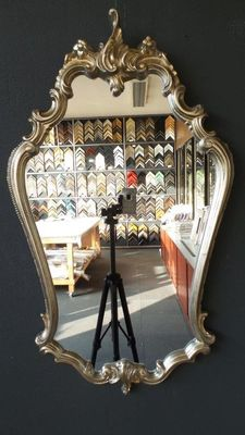 Venetian-style mirror with silver-plated frame.
