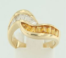 Yellow gold cross over ring set with baquette cut citrine and diamond