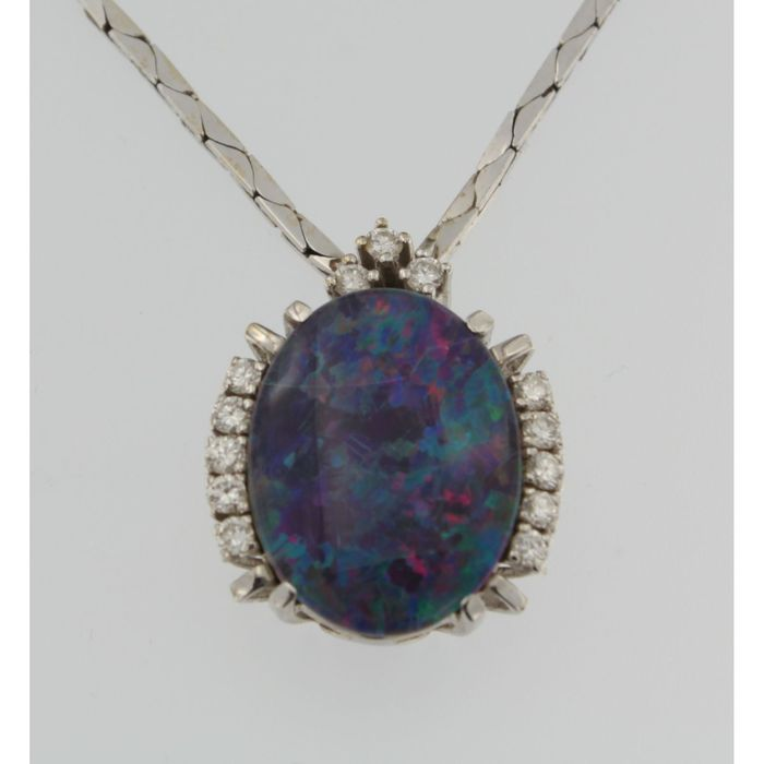 14 kt white gold necklace with a fixed pendant with brilliant cut diamonds 0.60 ct and an opal doublet , length 40 cm.