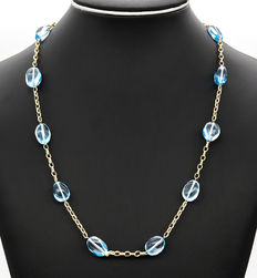 750/18 kt yellow gold – Necklace – Oval shape blue topaz – Length: 60 cm (approx.)