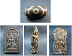 A 3 eye prayer bead or heirloom bead and 3 amulets - Thailand and Himalayas - mid and 2nd half of the 20th century