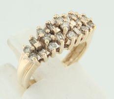 14 kt yellow gold ring, set with baguette cut and brilliant cut diamonds.