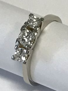 White gold trilogy ring with diamonds