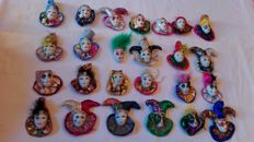 Lot of 25 porcelain masks with costumes.