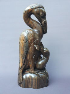 Coromandel wood statue, in Art Deco style, crane with young - Indonesia.