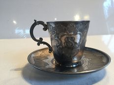 "One cup and saucer in silver metal  embossed ""ES"""