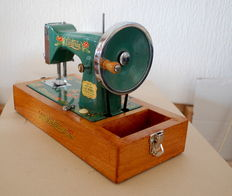 Small metal Mini VICTORIA Sewing machine in a wooden case,