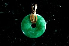 Chinese pendant made from green natural jade with decorations and pendant eyelet made from 750 gold