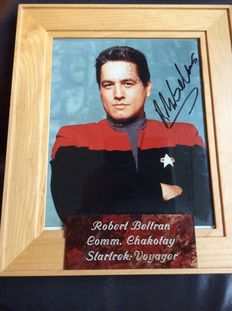 Star Trek Voyager - signed photo by Robert Beltran as Commander Chakotay - size incl frame 28cmx33cm