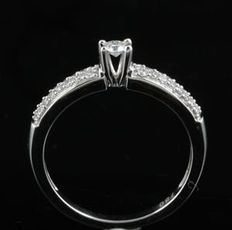 Brand new engagement ring with round diamonds in a micro claw setting. 0.25ct total weight. G colour, SI clarity set in 18kt white gold. Size 54/N (free re-sizing in Antwerp)