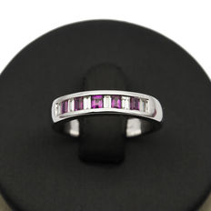 White gold ring with baguette-cut diamonds and baguette-cut rubies. Ring size: 12