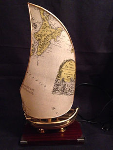 Antique appliqué sailboat with oars in bronze