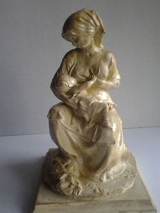Statue of a mother with a child, ca. 1920, France, earthenware