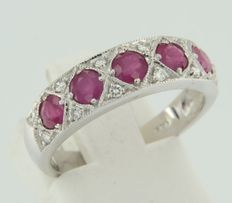 White gold 14 kt ring set with brilliant cut rubies and diamonds.
