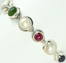 Silver bracelet set with natural pearls, ruby, sapphire and emerald.