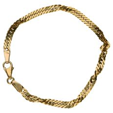 Yellow gold twisted figaro link bracelet of 14 kt