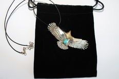 Necklace and eagle-shaped pendant in  Sterling (925) silver with a turquoise stone.