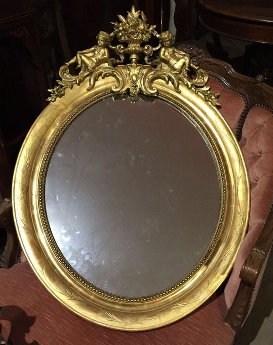 A Napoleon III carved and gilt wood mirror - France - late 19th century