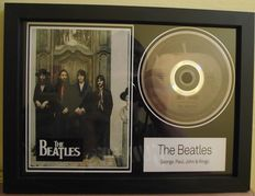 The Beatles, framed photo and  CD disc. 'Hey Jude', Apple label.