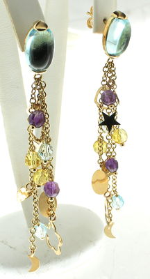 Yellow gold earrings set with topaz and amethyst.