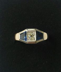 White and yellow gold ring with diamond.